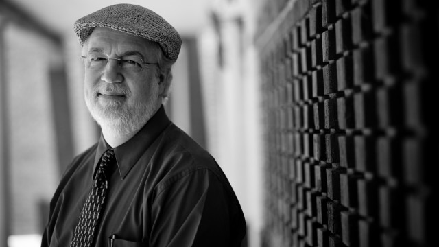 Black and white photo of senior lecturer Gregory Clinton, Ph.D.